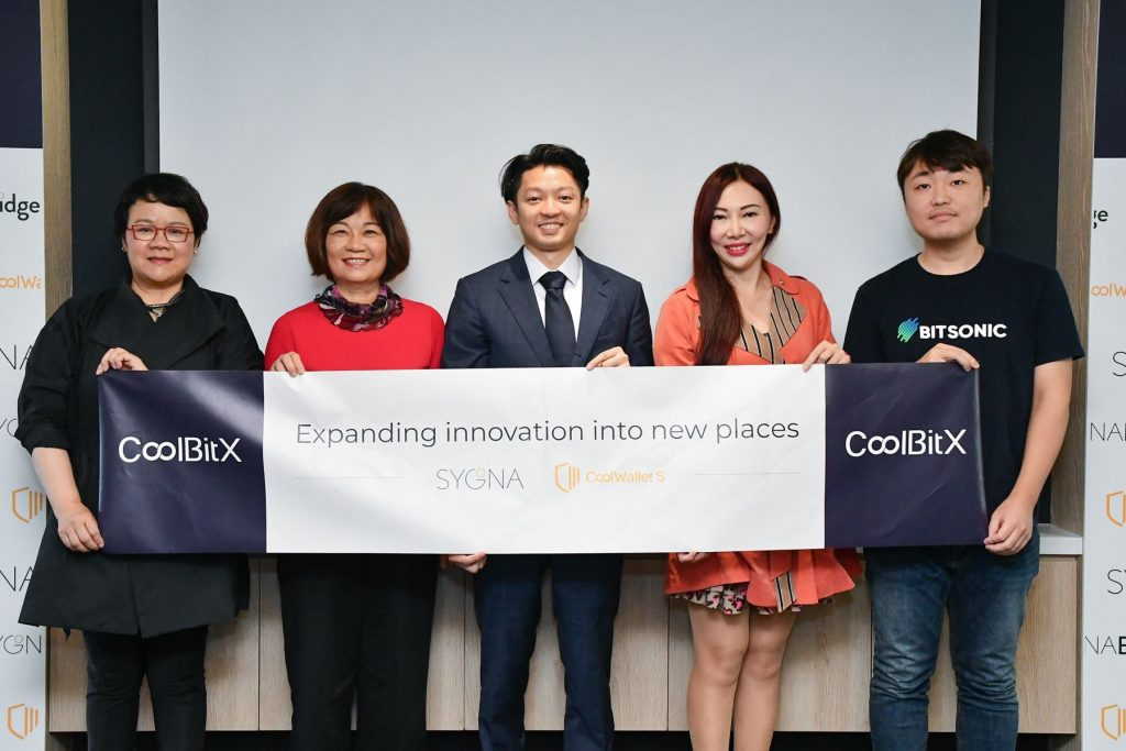 CoolBitX CEO Michael Ou (center) celebrates the Series B funding with his team and new investor Bitsonic's CEO Jinwook Shin